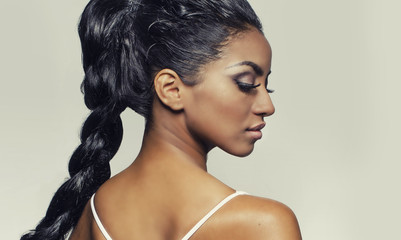 Beautiful profile shot of exotic young woman