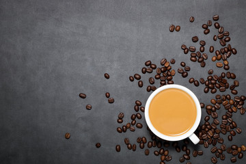 Coffee latte with coffee beans on dark background., Top view.