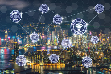 Wireless communication connecting of smart city Internet of Things Technology over the Scene of Hong Kong Cityscape river side at Victoria harbour, technology IOT concept