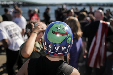 Jaeda Ferrel wears a helmet adorned with a hand-painted image of Pepe the frog and a Trump/Pence sticker at a rally organized by the right-wing group Patriot Prayer in Vancouver