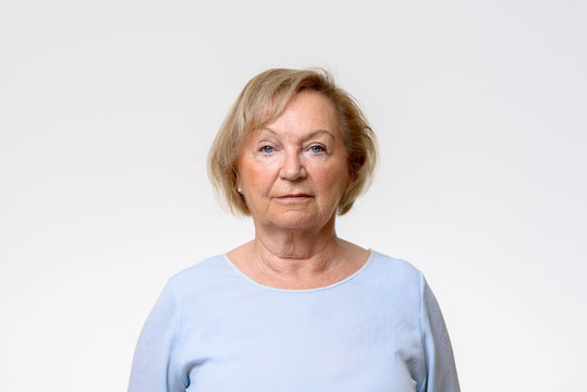 Elderly woman looking directly at the camera