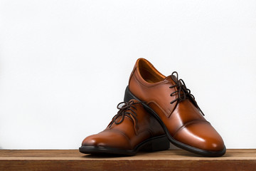 Brown fashion leather men shoes on table.