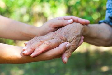 Shaking elderly hand