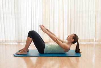 Sit up exercise. Woman doing abs workout.
