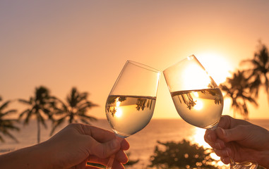 Wine cheers sunset.