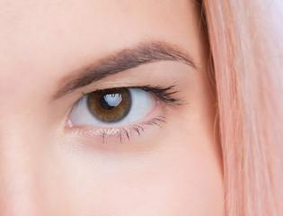 Closeup of female hazel eye looking at a camera