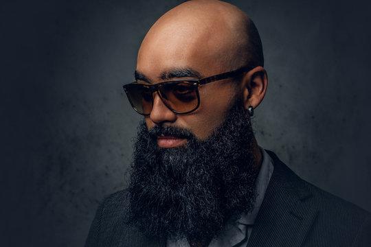 Arabic bearded shaved head male in sunglasses.