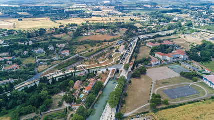 Poster Channel Aerial top view of Fonserannes locks on canal du Midi from above, unesco heritage landmark in France