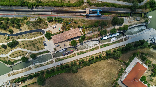 Aerial top view of Fonserannes locks on canal du Midi from above, unesco heritage landmark in France