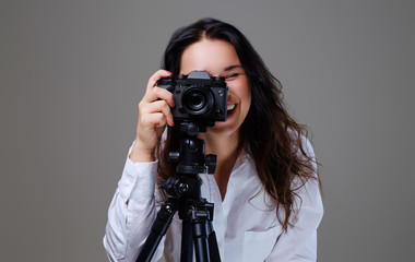 Female taking pictures with a professional photo camera.