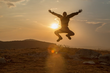 Silhouette of happy people jumping