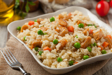 Delicious risotto with chicken and green peas.