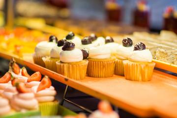 various dessert on display in bakery shop