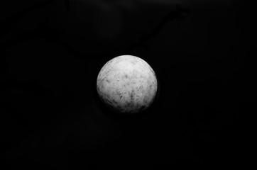 white ball on black