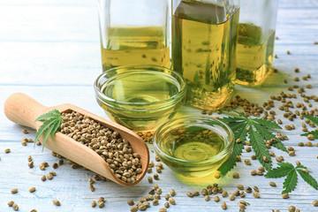 Composition with hemp oil on table