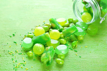 Green candies scattered on table