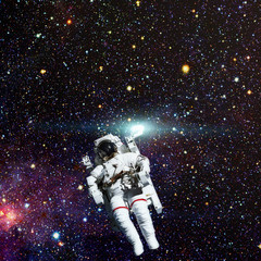 Astronaut in outer space. Nebula and stars on the background. Elements of this image are furnished by NASA