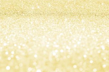 красивые золотые блестки на расплывчатом фоне