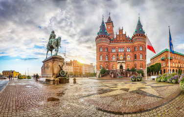 View on Helsingborg Town Hall from Stortorget square in rainy evening in Helsingborg, Sweden