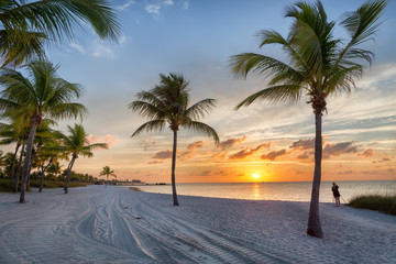 Photographer at sunrise on the Smathers beach - Key West, Florida