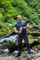 Professional nature photographer with camera on tripod