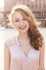 Smiling young woman in elegant clothing
