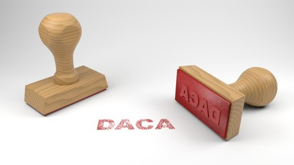 Two rubber stamps with the word DACA and a stamp on white