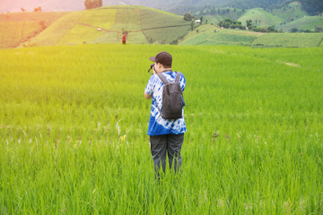 people take photo on nature with rice field.