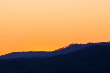 The pre-sunrise light of the sun begins to illuminate the hills near Heflin, Alabama, USA