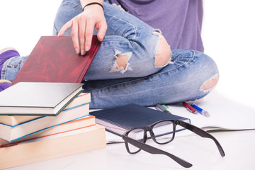 Closeup view of student legs and books