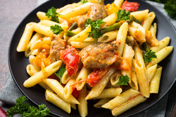 Pasta penne with meat and vegetables.