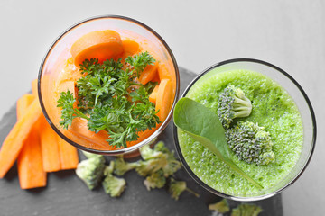 Fresh juices in glasses and ingredients on slate plate
