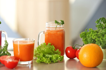 Fresh juices and ingredients on table