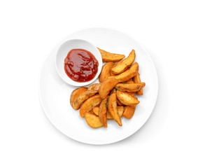 Plate with delicious baked potato wedges and sauce on white background