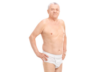 Mature man in underwear looking at the camera
