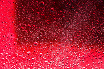 Drops of water on red surface. Macro abstract photo, background, texture