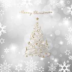 Christmas tree on silver background and Merry Christmas text.