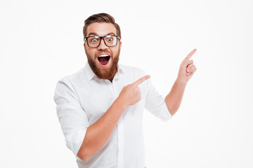 Happy excited bearded man in eyeglasses
