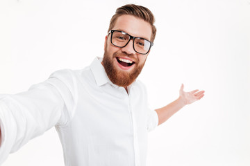Close up portrait of a happy cheerful bearded man Wall mural