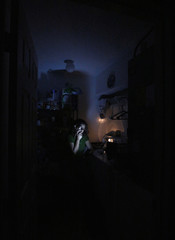 A few hours after losing all power, Cleyde Amorim of Brazil keeps tabs on news while riding out the worst oart of Hurricane Irma as it made its way through Kissimmee, Florida