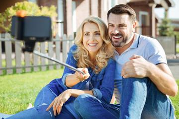 Beautiful couple taking a selfie in their yard