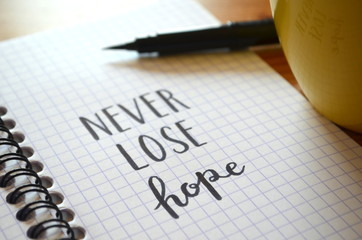 NEVER LOSE HOPE hand-lettered in notebook