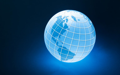 Glowing Globe with Wire frame latitude and longitude lines, part Photo part Illustration: Blue Global Business