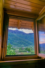 Window overlooking the mountains in the small town of Plav.