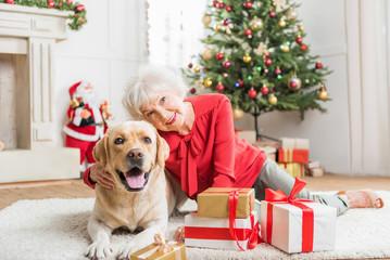 Joyful old elegant woman is resting with pet