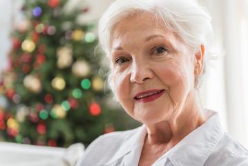 Elegant elderly woman is expressing positiveness