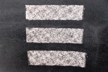White chalk paint texture on black board background for decoration or grunge layer