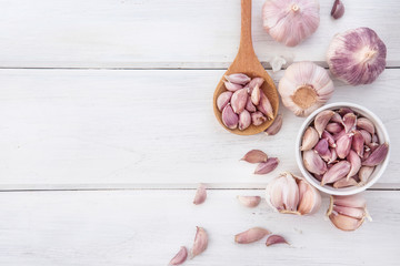 Close up the group of garlic on white wooden table board , top view or overhead shot with copy space Wall mural
