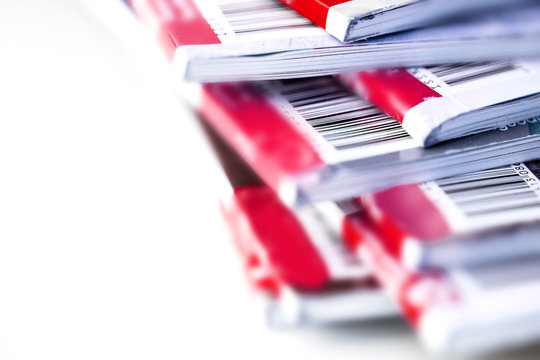 Close up the part of barcode on red magazine stacking with white background , background for copyright article concept