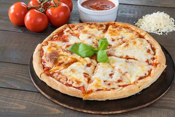 Fresh Pizza on Wood Table